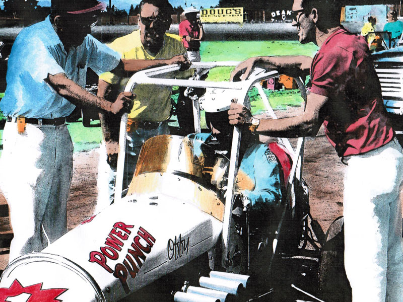 1969 WMRA Champion Kenny Petersen drove the Power Punch midget at Tacoma. He is flanked by Bill Siedelman, Tom Glithero and Bob Halmer.